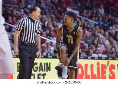 PHILADELPHIA - JANUARY 4: UCF Knights guard Calvin Newell (11) discusses a foul call with an official during the American Athletic Conference basketball game January 4, 2015 in Philadelphia.