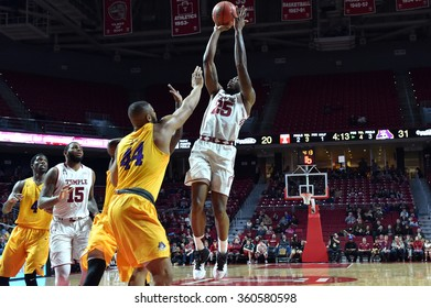 PHILADELPHIA - JANUARY 9: Temple Owls guard Quenton DeCosey (25) takes a jump shot during the American Athletic Conference  basketball game January 9, 2016 in Philadelphia.