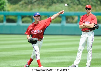 PHILADELPHIA - JULY 26: Philadelphia Phillies pitcher Jamie Moyer throws prior to the game July 26, 2009 in Philadelphia. Cole Hamels watches.