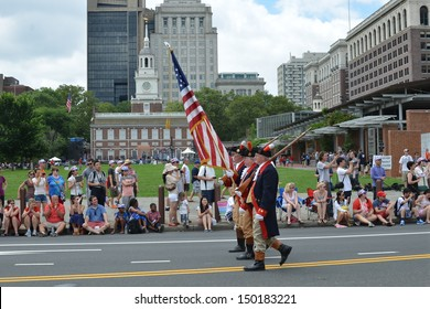 PHILADELPHIA- JULY 4: The Mattatuck Drum Band marches in the Independence Day Parade as it makes its way along Market St. on July 4, 2013 in Philadelphia, PA.
