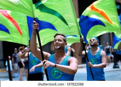 PHILADELPHIA - JUNE 8: Flaggots colorguards spinning flags at the 26th Annual Pride Parade on the streets of Center City Philadelphia on June 8th, 2014 in Philadelphia.