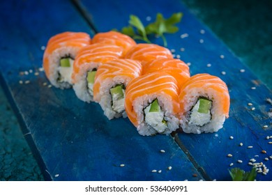 The Philadelphia maki on the deep blue Table