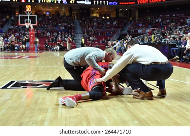 PHILADELPHIA - MARCH 25: Louisiana Tech Bulldogs guard Kenneth Smith (4) grabs his ankle in pain after an injury during the NIT quarterfinal basketball game March 25, 2015 in Philadelphia.
