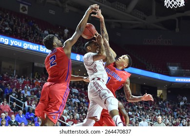 PHILADELPHIA - MARCH 25: Temple Owls guard Jesse Morgan (3) is fouled as he shoots during the NIT quarterfinal basketball game March 25, 2015 in Philadelphia.