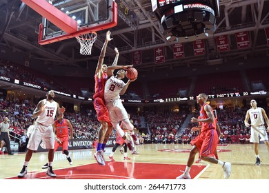 PHILADELPHIA - MARCH 25: Temple Owls guard Will Cummings (2) makes contact as he goes up for a shot during the NIT quarterfinal basketball game March 25, 2015 in Philadelphia.