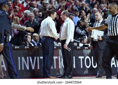 PHILADELPHIA - MARCH 25: Temple Owls head coach Fran Dunphy and Louisiana Tech head coach Michael White shake hands following the NIT quarterfinal basketball game March 25, 2015 in Philadelphia.