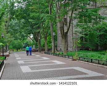 PHILADELPHIA - MAY 2019:  Locust Walk on the campus of the University of Pennsylvania, a long shady walkway named for the locust trees that surround it.
