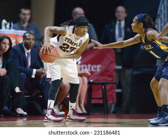PHILADELPHIA - NOVEMBER 14:  Temple Owls guard Tyonna Williams (23) looks to pass out of the corner during the season opening ladies basketball game against LaSalle November 14, 2014 in Philadelphia.