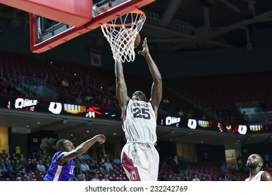 PHILADELPHIA - NOVEMBER 17: Temple Owls guard Quenton DeCosey (25) rises up for a lay-up during the NCAA basketball game November 17, 2014 in Philadelphia.