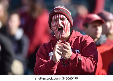 PHILADELPHIA - NOVEMBER 21: A Temple Owls fan with facepaint cheers during the AAC football game November 21, 2015 in Philadelphia.