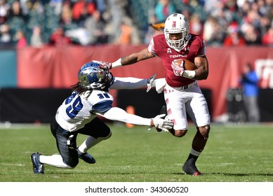 PHILADELPHIA - NOVEMBER 21: Temple Owls running back Jahad Thomas (5) stiff arms a defender during the AAC football game November 21, 2015 in Philadelphia.