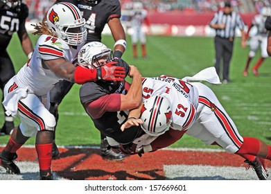 PHILADELPHIA - OCTOBER 5: Louisville Cardinals defensive end Nick Dawson (52) hits the Temple QB in the end zone in a AAC football game against Temple October 5, 2013 in Philadelphia
