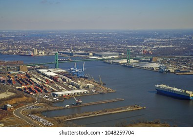 PHILADELPHIA, PA -10 MAR 2018- Aerial view of the Walt Whitman Bridge, a green-colored single-level suspension bridge spanning the Delaware River from Philadelphia to Gloucester City, New Jersey.