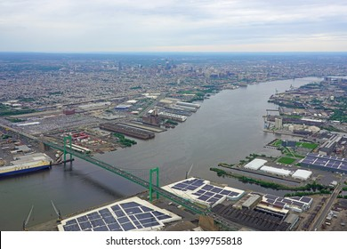 PHILADELPHIA, PA -11 MAY 2019- Aerial view of the port of Philadelphia, shipyards along the Delaware River and the city of Philadelphia, Pennsylvania in the background.