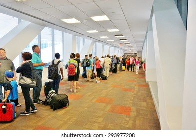 PHILADELPHIA, PA- 22 JUNE 2015- Passengers wait in line at the TSA security check at the Terminal A at the Philadelphia International Airport (PHL).