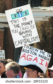 PHILADELPHIA, PA - APRIL 18: Protesters carry placards during tea party protest April 18, 2009 in Philadelphia. The protest is a modern-day protest to the government's spending of billions of dollars.