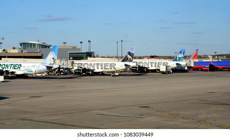 Philadelphia, PA - April 22nd, 2018: A Row of Frontier Airlines Planes is Parked at Philadelphia International Airport's Terminal E