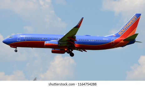 Philadelphia, PA - August 20th, 2018: A Southwest Airlines Boeing 737-8H4 Landing with an Illuminated Beacon Light