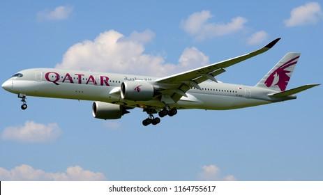 Philadelphia, PA - August 20th, 2018: A Qatar Airways Airbus A350-941 Landing with an Illuminated Beacon Light