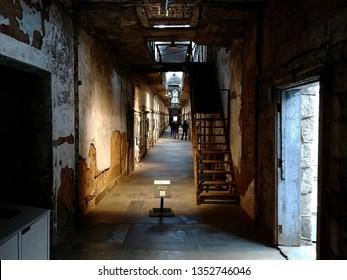Philadelphia, PA - December 15 2015: A dimly lit cellblock inside historic Eastern State Penitentiary