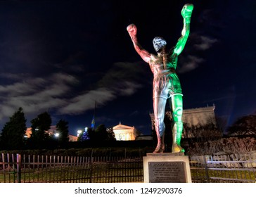 Philadelphia, PA - December 3, 2018: Rocky Balboa Statue Lit in Red, White and Green