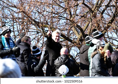 PHILADELPHIA, PA - February 8, 2018: Eagles' head coach Doug Pederson salutes fans atop tour bus at Super Bowl LII championship parade