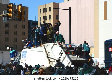 Philadelphia, PA - February 8th, 2018: Eagles Fans Climb on top of a Garbage Truck after the Eagles Victory Parade