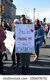 PHILADELPHIA, PA - JANUARY 20, 2018: protester holding protest sign at Women's March on Philadelphia