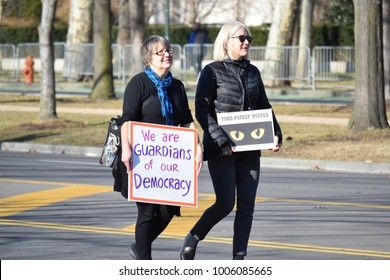 PHILADELPHIA, PA - JANUARY 20, 2018: protesters holding protest signs at Women's March on Philadelphia