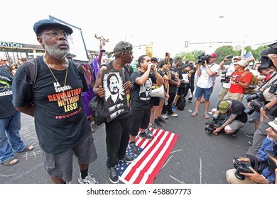 PHILADELPHIA, PA: - JULY 25 2016: thousands of left wing activists descended on downtown Philadelphia & FDR Park to protest day one of the DNC. Revolutionary communist party members stomp on US flag