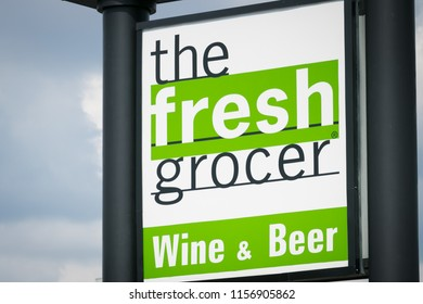"""Philadelphia, PA - July 26, 2018: """"The Fresh Grocer"""" chain grocery store sign, also featuring wine and beer for sale."""