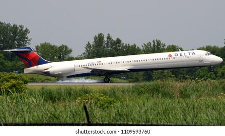 Philadelphia, PA - June 3rd, 2018: A Delta Airlines Douglas MD-88 Touching Down while Landing at Philadelphia International Airport