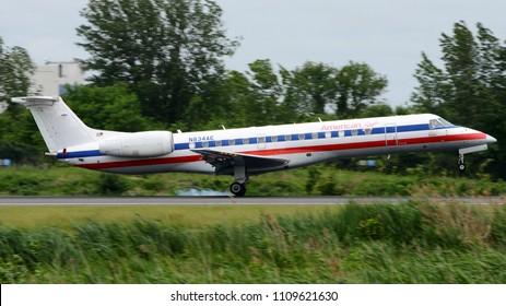 Philadelphia, PA - June 3rd, 2018: An American Eagle Embraer ERJ-140 in a 90's Livery Landing at Philadelphia International Airport