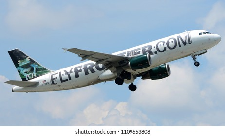 "Philadelphia, PA - June 3rd, 2018: A Frontier Airlines Airbus A320-200, ""Bugsy the Tree Frog"", departing Philadelphia International Airport"