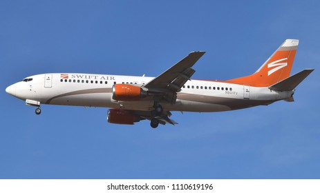 Philadelphia, PA - June 9th, 2018: A Swift Air Boeing 737-4B7 Landing at Philadelphia International Airport