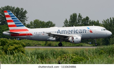 Philadelphia, PA - June 9th, 2018: An American Airlines Airbus A319-112 Landing at Philadelphia International Airport with Thrust Reversers Deployed
