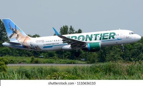 "Philadelphia, PA - June 9th, 2018: A Frontier Airlines Airbus A320-214, ""Buck the Pronghorn"", Landing at Philadelphia International Airport"
