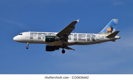 "Philadelphia, PA - June 9th, 2018: A Frontier Airlines Airbus A320-214, ""Montana the Elk"", Landing at Philadelphia International Airport"
