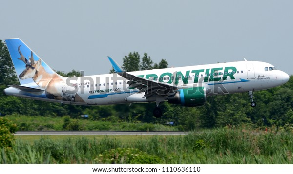"""Philadelphia, PA - June 9th, 2018: A Frontier Airlines Airbus A320-214, """"Buck the Pronghorn"""", Landing at Philadelphia International Airport"""