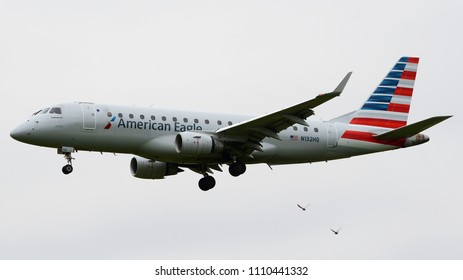 Philadelphia, PA - March 25th, 2018: An American Eagle Embraer ERJ-175 Landing at Philadelphia International Airport