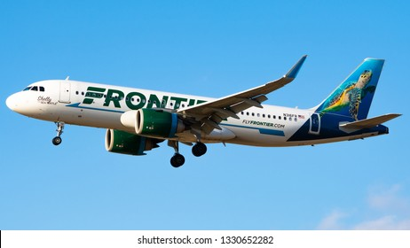 Philadelphia, PA - March 4th, 2019: A Frontier Airlines Airbus A320-251N, Shelly the Sea Turtle, Landing