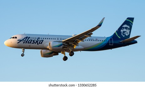 Philadelphia, PA - March 4th, 2019: An Alaska Airlines Airbus A320-214 Landing in the Late Evening
