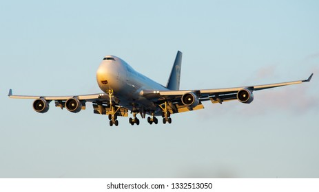 Philadelphia, PA - March 4th, 2019: A UPS Boeing 747-400 Freighter Landing, Illuminated by the Sunset