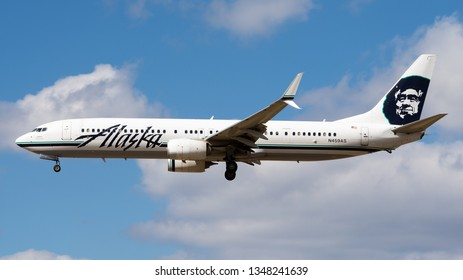 Philadelphia, PA - March 4th, 2019: An Alaska Airlines Boeing 737-990ER Retro Livery Landing in Partly Cloudy Weather