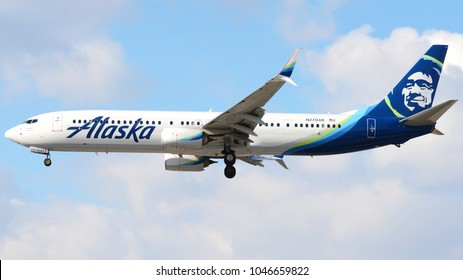 Philadelphia, PA - March 9th, 2018: An Alaska Airlines Boeing 737-990ER landing at Philadelphia International Airport in front of a cloudy sky