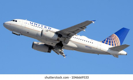 Philadelphia, PA - March 9th, 2018: A United Airlines A319-132 Taking Off from Philadelphia International Airport with its Landing Gear Doors Open in front of a Clear Blue Sky
