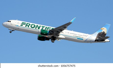 "Philadelphia, PA - March 9th, 2018: A Frontier Airlines Airbus A321, Nicknamed ""Steve the Eagle"", Takes Off from Philadelphia International Airport with its Red Beacon Light Flashing"
