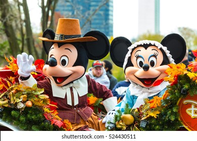 Philadelphia, PA - November 24, 2016: Mickey and Minnie Mouse ride in a carriage in the annual Thanksgiving Day parade.