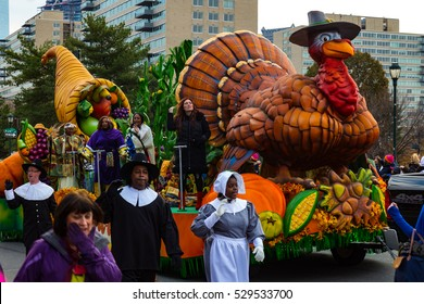 Philadelphia, PA - November 24, 2016: Pilgrims march alongside a turkey float in the annual Thanksgiving Day parade in the City of Brotherly Love.