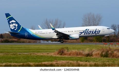 Philadelphia, PA - November 25th, 2018: An Alaska Airlines Boeing 737-990ER Touching Down at Philadelphia International Airport with Smoking Tires